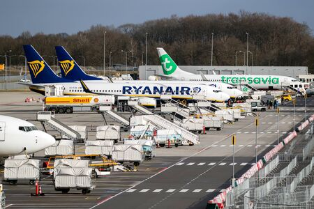EINDHOVEN, THE NETHERLANDS - FEB 9, 2019: Low-budget airlines Ryanair and Transavia aircraft parked at the terminal of Eindhoven Airport.