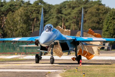 KLEINE BROGEL, BELGIUM - SEP 14, 2019: Ukrainian Air Force Sukhoi Su-27 Flanker fighter jet aircraft taxiing with parachute after landing on Kleine-Brogel Airbase.