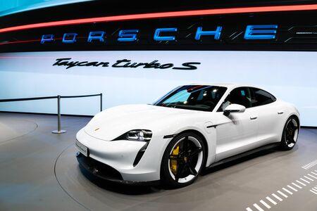 FRANKFURT, GERMANY - SEP 11, 2019: New 2020 Porsche Taycan Turbo S sports car reveiled at the Frankfurt IAA Motor Show 2019. Редакционное