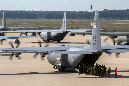 Paratroopers entering a US Air Force C-130 Hercules transport plane on Eindhoven airbase.