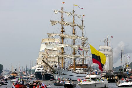 AMSTERDAM, NETHERLANDS - AUGUST 19, 2015: Colombian navy tall ship ARC Gloria among others in the North Sea Canal enroute to Amsterdam to particiate in the SAIL 2015 event.