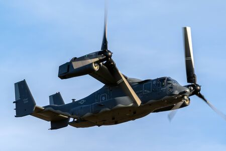 SANICOLE, BELGIUM - SEP 13, 2019: US Air Force Bell Boeing V-22 Osprey tiltrotor military aircraft performing a flyby at the Sanice Sunset Airshow.