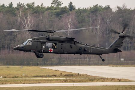 EINDHOVEN, THE NETHERLANDS - FEB 4, 2019: United States Army Sikorsky HH-60M Blackhawk transport helicopter in flight.