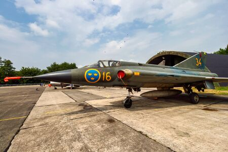 BEAUVECHAIN, BELGIUM - JUL 3, 2010: Former Swedish Air Force Saab 35 Draken fighter jet aircraft on the tarmac of Beauvechain airbase.