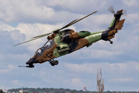 LE BOURGET PARIS - JUN 21, 2019: French Army Eurocopter Airbus EC-665 Tiger attack helicopter in flight at the Paris Air Show.