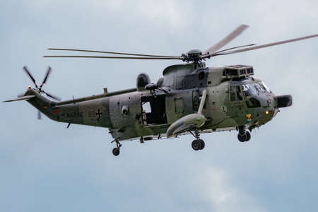German Navy Sikorsky S-61 Sea King rescue helicopter arriving at Nordholz airbase. Germany - June 14, 2019 Editorial