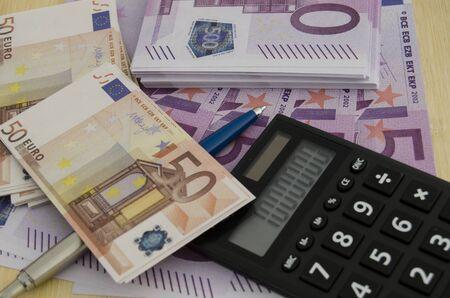 Euro bills with a calculator