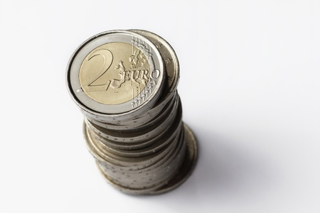 transact: A two euros coin tower isolated on a white background