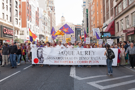 demanding: 26th Sept, 2015: Madrid, Spain. People protesting in Gran Via Street demanding a Spanish Republic during a demonstration in Madrid against Monarchy
