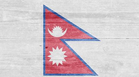 nepali: The Nepali flag on a wood plank