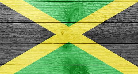 jamaican flag: The Jamaican flag on a wood plank
