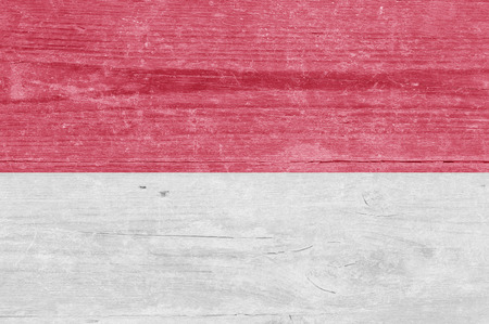 the indonesian flag: The Indonesian flag on a wood plank Stock Photo