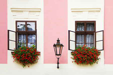 two old open window with flowers and lamp photo