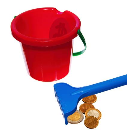 bucket of money: Raking money with children Stock Photo