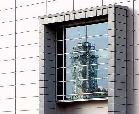 opposite: window with a reflection of the opposite tower