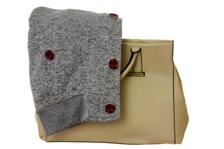 sudadera: Beige handbag and gray sweatshirt before autumn walk