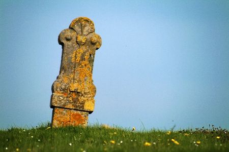gravesite: Ancient gravesite with unmarked gravestones from the 1600s in the middle of a meadow. Stock Photo