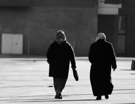 streetscene: Two islamic women walking on the street Stock Photo