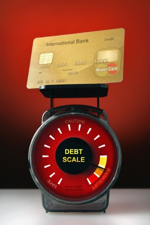 Credit card on debt scale photo
