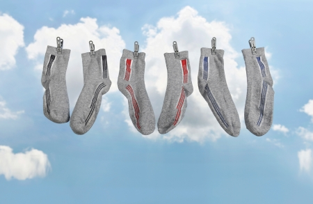 Socks hanging wireless in the air to dry out