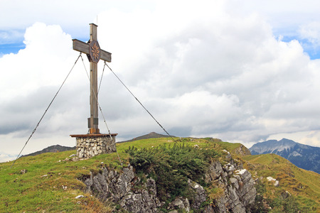 flit: summit with summit cross in the rofan mountains of the alps (rofan)