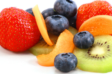 vitamines: different fruits - strawberry, blueberry and apricot, kiwi - placed together