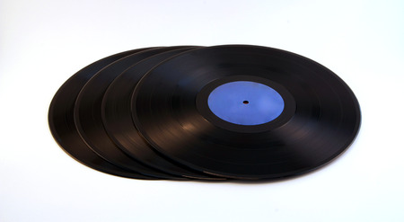 rill: a pile of black vinyl with white background