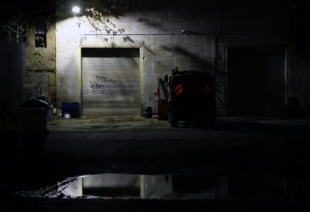 clearer: view on a mystical scene of a garage and vehicle by night Stock Photo