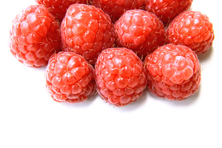 vitamines: closeup of a bunch of red and fresh raspberries Stock Photo