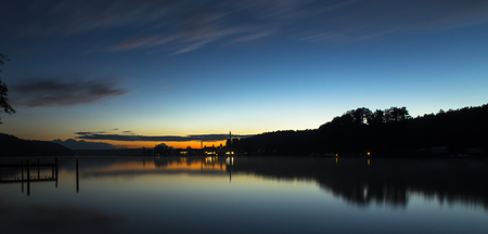 silhouette and reflections on the werbellinsee at dawn light Stock Photo