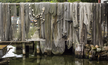 landing stage: grey fishnets on a landing stage by daylight