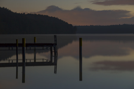 landing stage: landing stage and reflections on the werbellinsee at dawn light Stock Photo