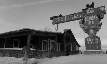 An abandoned Inn along the highway in Wyoming during Winter.