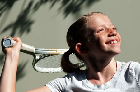 Confident Elementary Age Girl on the Tennis Court. photo