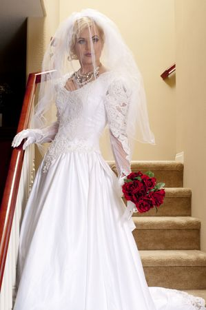 striptease: Full Length Bride on Staircase with Veil Stock Photo