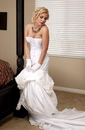 Beautiful Voluptuous Bride Undressing in Her Bedroom 免版税图像