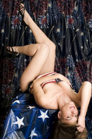 Reclining Gorgeous Model in American Flag and Daisy Dukes