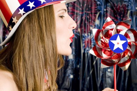 Patriotic Girl with Red, White and Blue Hat and Pinwheel photo