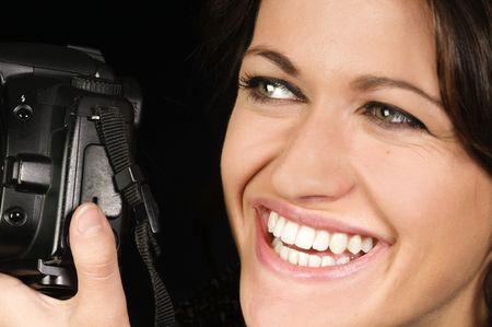 Close-up of Smiling Female Photographer w/SLR Stock Photo - 7990133