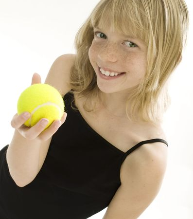 Confident Elementary Age Girl with Tennis Ball. Stock Photo - 7990106