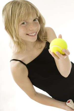 Confident Elementary Age Girl with Tennis Ball. Stock Photo - 7990121
