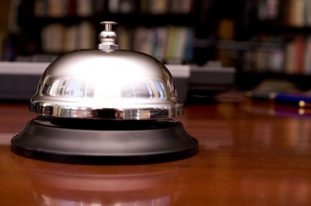 service desk: Service Bell on Desk with Pen and Keyboard Background.  Shallow DOF. Stock Photo