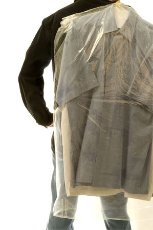 Rearview of man with dry cleaning bag.