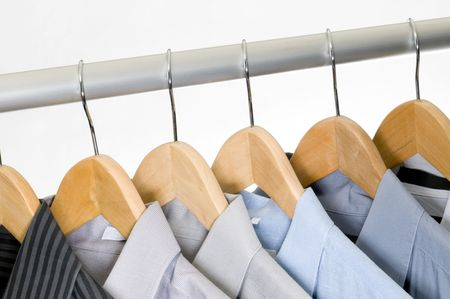 Dress shirts on wooden hangers. photo