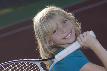 Confident Elementary Age Girl on the Tennis Court. Stock Photo - 7990302