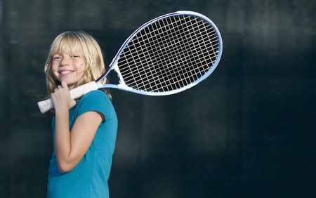 tennis racquet: Confident Elementary Age Girl on the Tennis Court