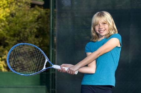 raquet: Confident Elementary Age Girl on the Tennis Court