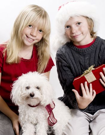 Cute Siblings and their Puppy Dog in the Christmas Spirit! photo