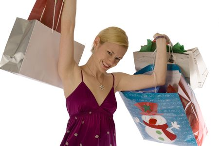 Glowing young blonde celebrating with shopping bags! photo