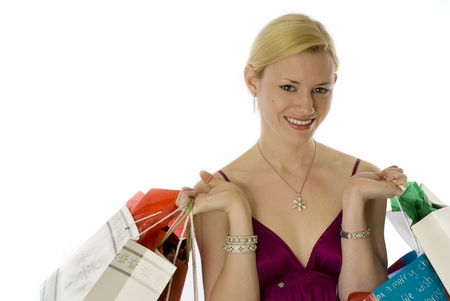 laden: Glowing young blonde laden with shopping bags! Stock Photo